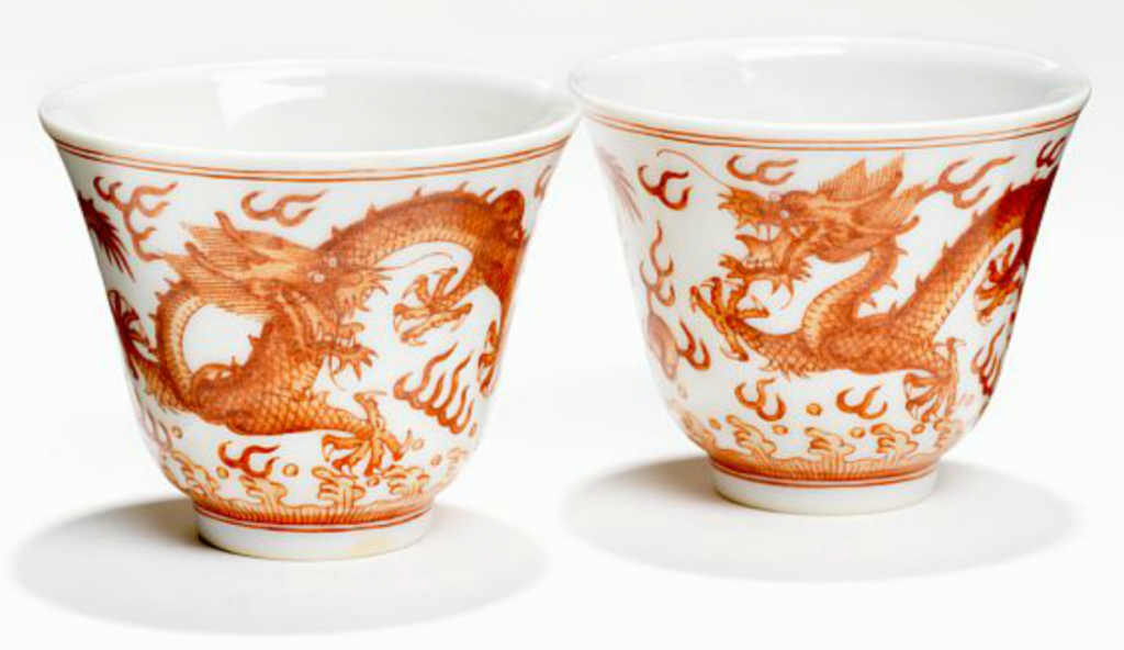 Two Chinese porcelain bell-shaped wine cups decorated in iron-red with five-clawed dragons pursuing the flaming pearls. Guangxu 1875-1912 six-character mark in underglaze blue and from the period. H. 5 cm. Price est.: DKK 10,000 (€1,350) http://www.bruun-rasmussen.dk/search.do?iid=300800423&mode=detail