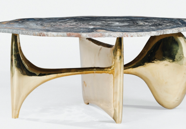 Table by Peter Hiquily hammered brass, petrified wood tray  Stamped Hiquily and numbered EA 2/2 on base.  48 x 128 x 80 cm. Price est.: € 50,000-70,000. Sotheby's
