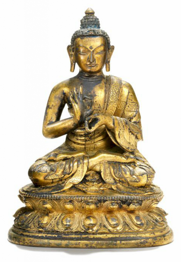A Chinese gilt bronze figure of the Teaching Buddha, seated in dhyanasana on a double lotus throne, dressed in monk's robe with richly decorated borders engraved with flowers and foliage, hair with remains of blue colour. Qianlong 1736-1795. Weight 1280 gr. H. 16 cm. Price est.: kr 40,000-60,000