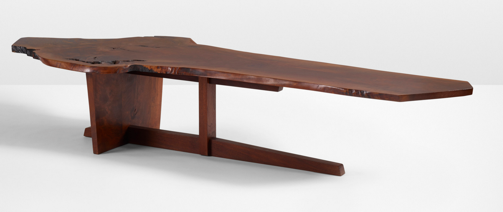 GEORGE NAKASHIMA Important Minguren II coffee table USA, 1973 American black walnut 92½ w x 32 d x 18 h in (235 x 81 x 46 cm) estimate: $120,000–180,000