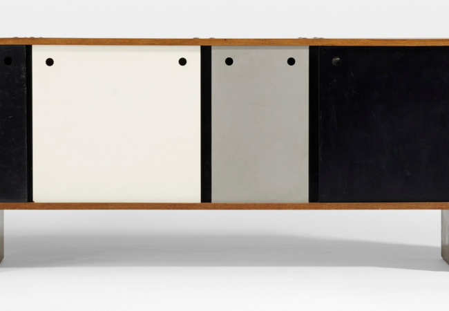 CHARLOTTE PERRIAND. Rare Bloc Bahut from Cité Cansado, Mauritania. Négroni and Métal Mueble for Galerie Steph Simon France, 1958 ash, enameled steel, aluminum, masonite, plastic 99 w x 18 d x 30¾ h in (251 x 46 x 78 cm) Price est.: $100,000–150,000