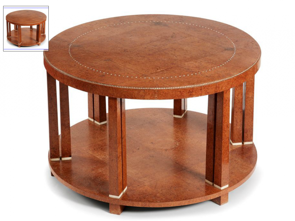 "Emiles-Jacques Ruhlmann (1879-1933) A ""Twelve pillars"" circular marquetried Amboina burl veneer coffee table, c.1920-1922. High. 50cm - Diam. 79,4cm . Price est.: € 80.000 to 120.000"