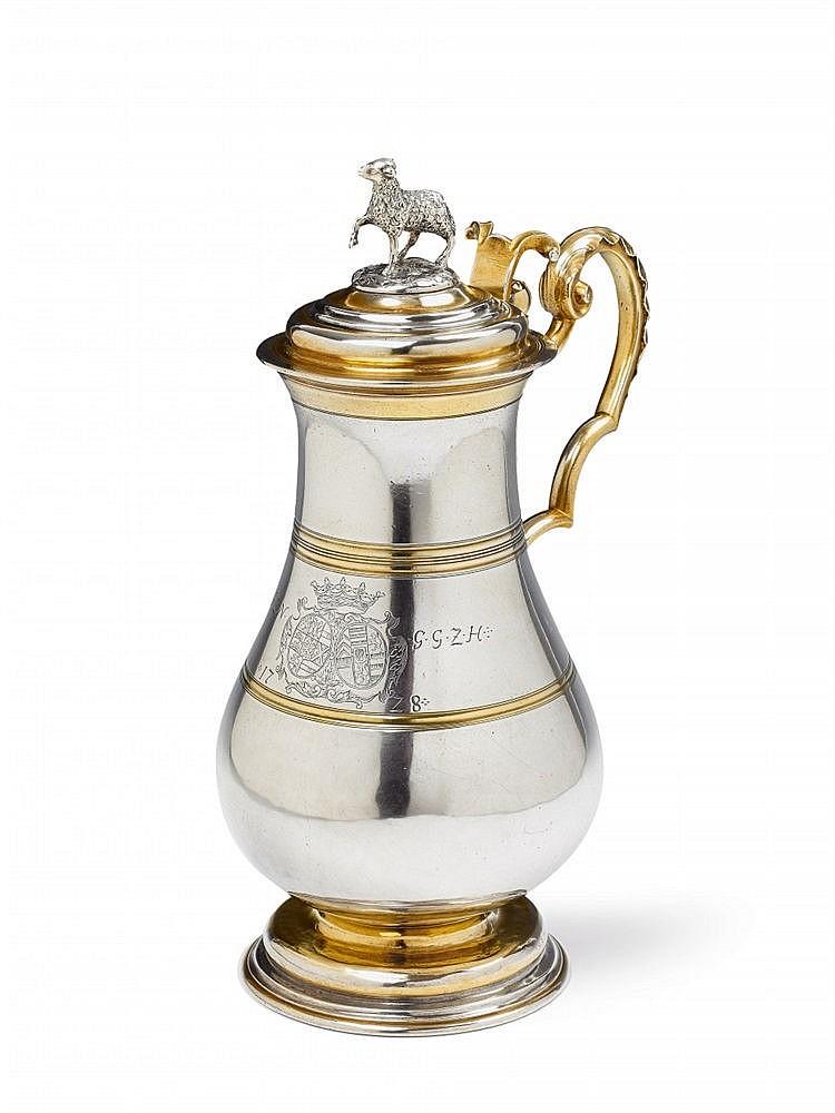 An important partially gilt Augsburg silver communion jug made for the counts of Nassau-Saarbrücken. H 30 cm, weight 1,182 g. Maker: Marks of Johann II Pepfenhauser, 1728.