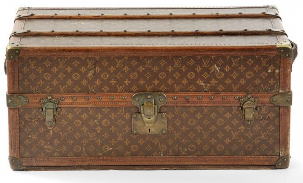 "LOUIS VUITTON Malle bed (the bed shortage) monogrammed BB. Edges Lozine. leather handles  Interior canvas of red cloth and white  label ""Louis Vuitton Scribe street"" numbered trunk No. 176210? Price Estimate: € 4.000 to 6.000"