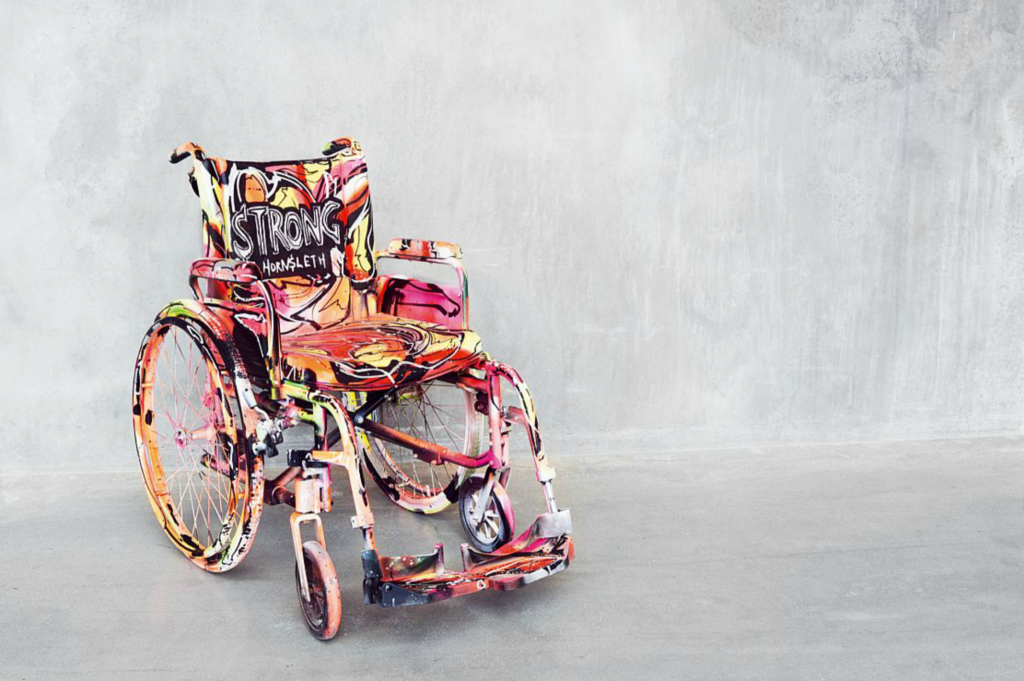 "Kristian von Hornsleth: ""Strong"", 2016. Polychrome decorated wheelchair. H. 105, L 100, B. 65. Price est.: € 2.700-4.050"