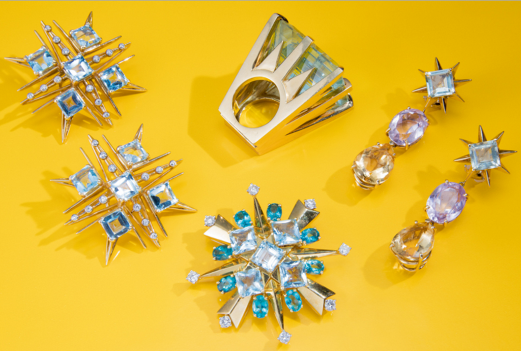 (Clockwise from top left) Pair of 18 Karat Gold, Blue Topaz and Diamond Earclips, Tony Duquette. Estimate $5,000–7,000; 18 Karat Gold and Aquamarine Ring, Tony Duquette. Estimate $7,000–9,000; Pair of 18 Karat Gold, Amethyst, Citrine and Prasiolite Earclips, Tony Duquette. Estimate $4,000–6,000; 18 Karat Gold, Aquamarine, Apatite and Diamond Brooch, Tony Duquette. Estimate $8,000–10,000.