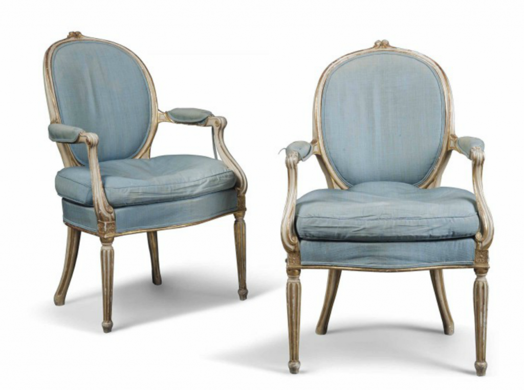 A pair of George III parcel-gilt and cream painted elbow chairs. Late 18th century. Estimate GBP 1,500 - GBP 2,500 Christie's