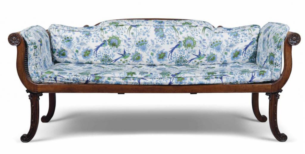 "A Regency walnut framed caned sofa. Early 19th century. ""Campaign"" Style."