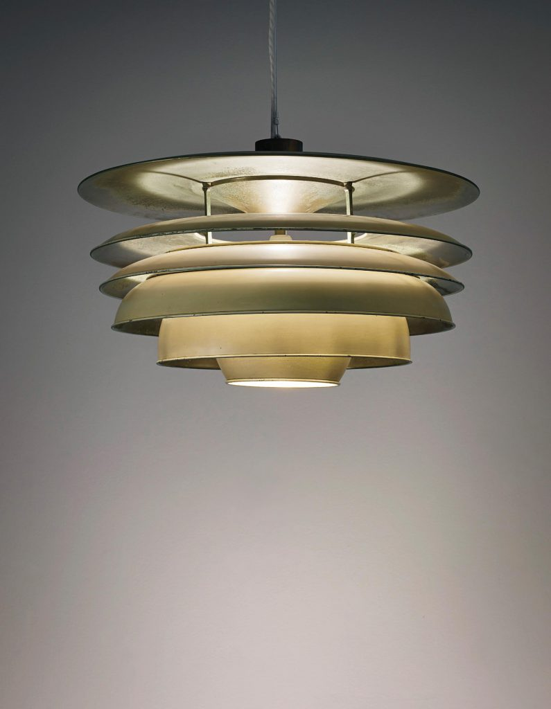 POUL HENNINGSEN Rare 'Paris' ceiling light, designed for the Denmark pavillion, L'Exposition Internationale des Arts Décoratifs et Industriels Modernes, Paris designed 1925  Brass, painted brass, tubular brass. 60 cm (23 5/8 in.) diameter, variable drop Manufactured by Lauritz Henriksen's Metalvarefabrik for Louis Poulsen, Copenhagen, Denmark. Estimate £70,000 - 100,000. Photo by Phillips.