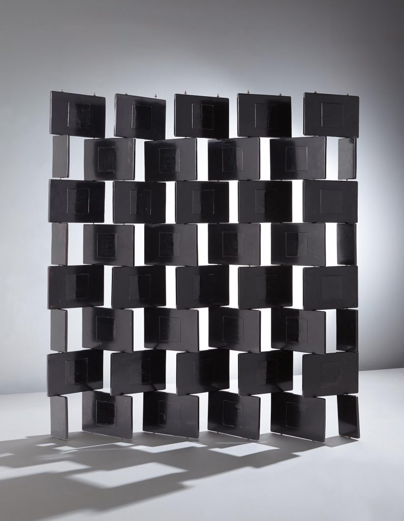 Eileen Gray, Folding 'Brick' screen, c. 1925. Black lacquered wood, steel, brass. Sold for £1,482,500 at Phillips. Photo courtesy of Phillips.