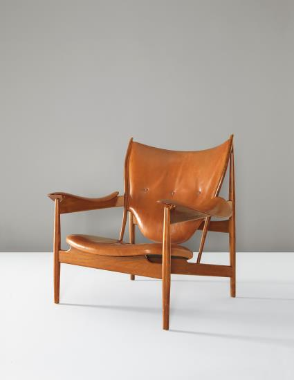 Finn Juhl, 'Chieftain' armchair, circa 1950. Teak, leather. 93.7 x 102.9 x 90.8 cm. Executed by cabinetmaker Niels Vodder, Denmark. Price est.: £150,000 - 250,000. SOLD FOR £290,500 in September 2014 at Phillips