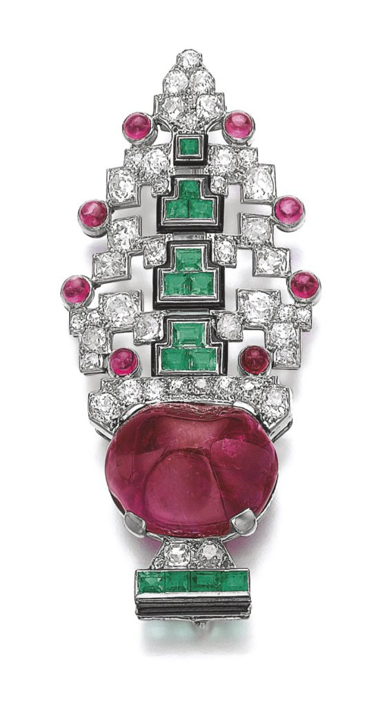 Art Deco brooch with rubies, emeralds, enamel and diamonds, Cartier, 1920s. Sold for € 493,303 Sotheby's